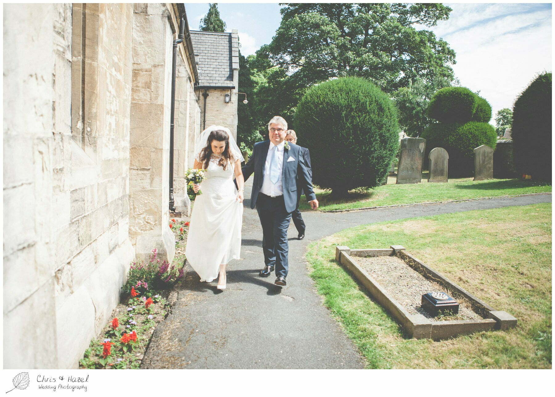 bride walking to church with father, st marys church, wedding, south milford Wedding Photographer, the engine shed, Wedding Photography wetherby, Chris and Hazel Wedding Photography, stevie pollard, stevie standerline, paul standerline,