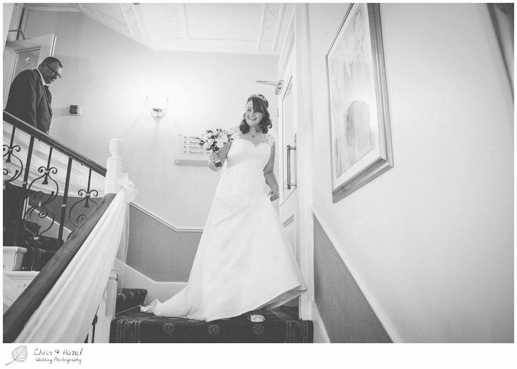 bride walking down stairs, Ilkley wedding photographer, Ilkley wedding photography, The Craiglands hotel wedding photography, west Yorkshire wedding photography, chris and hazel wedding photography, emily nunwick, sam nicholson, emily nicholson,