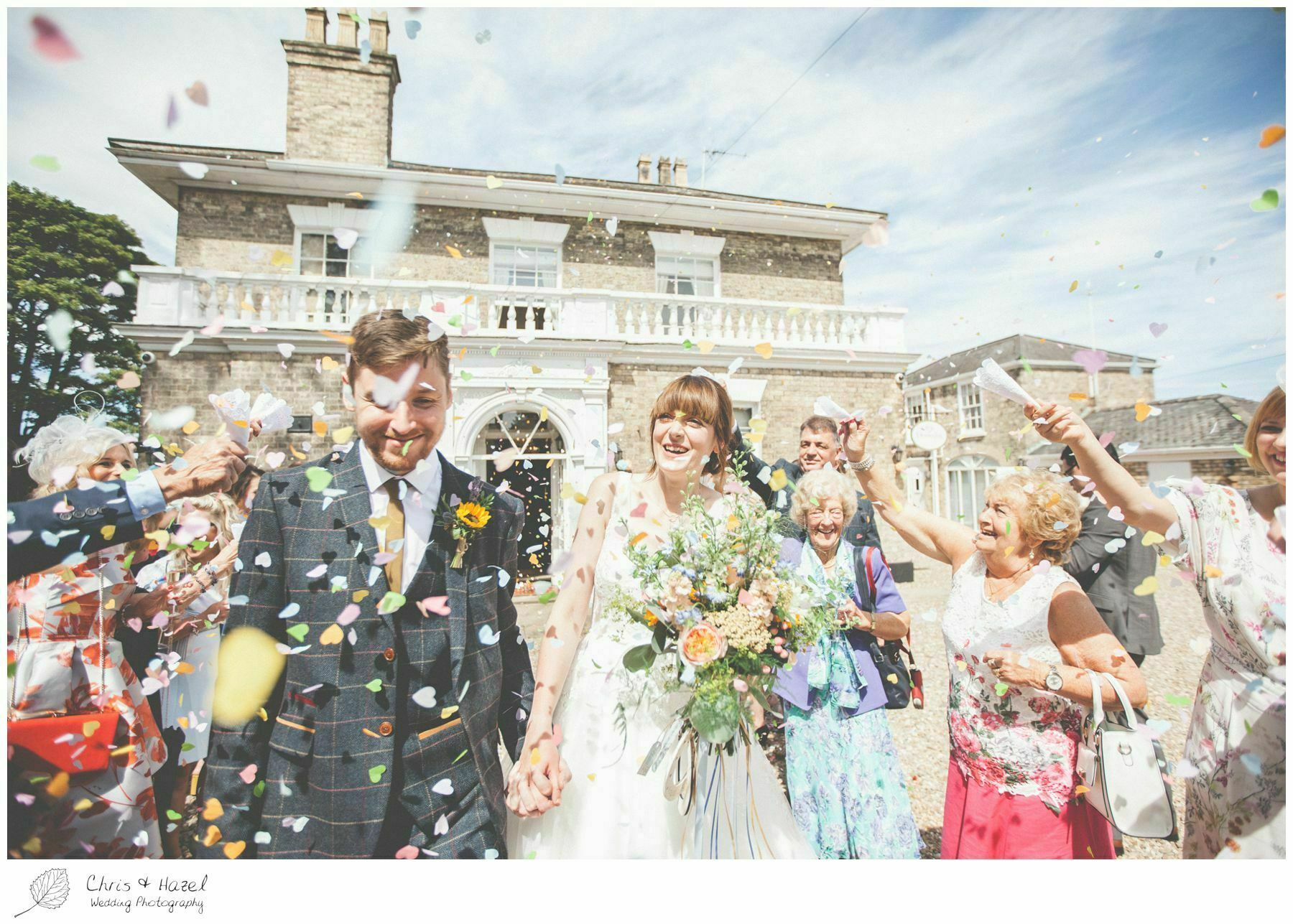 bride and groom covered in confetti shot wedding reception dunedinn country house wedding photography hull by chris and hazel wedding photography Richard walker gemma wrightson