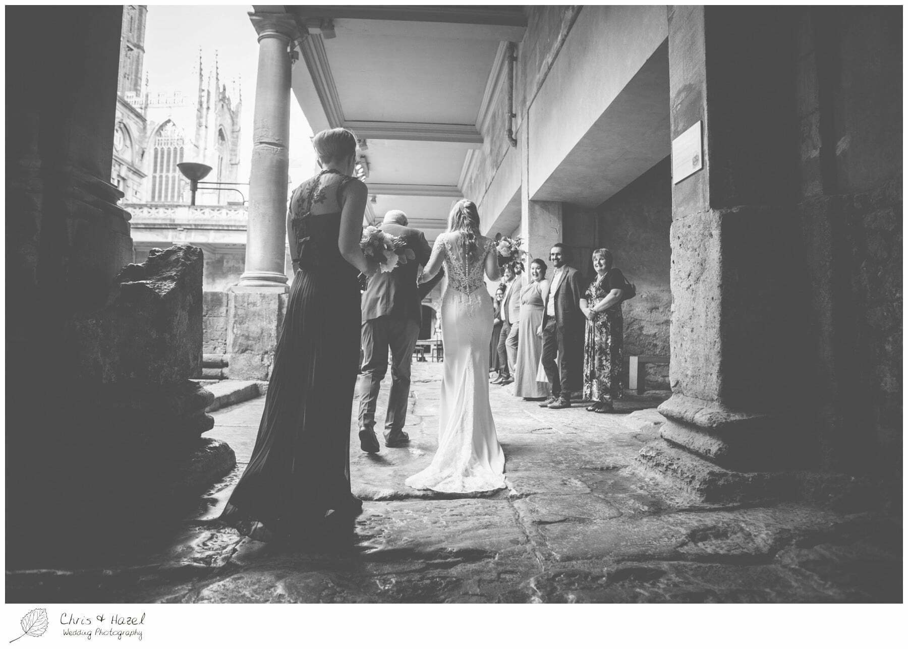 Bride walking down aisle at Roman Baths Pump Rooms, The Roman Baths Wedding Photography, Roman Baths Wedding Photographer, Wedding in Bath, Bath Wedding Day, documentary wedding photography, Chris and Hazel Wedding Photography Bath, Andy Frost Sian Upson