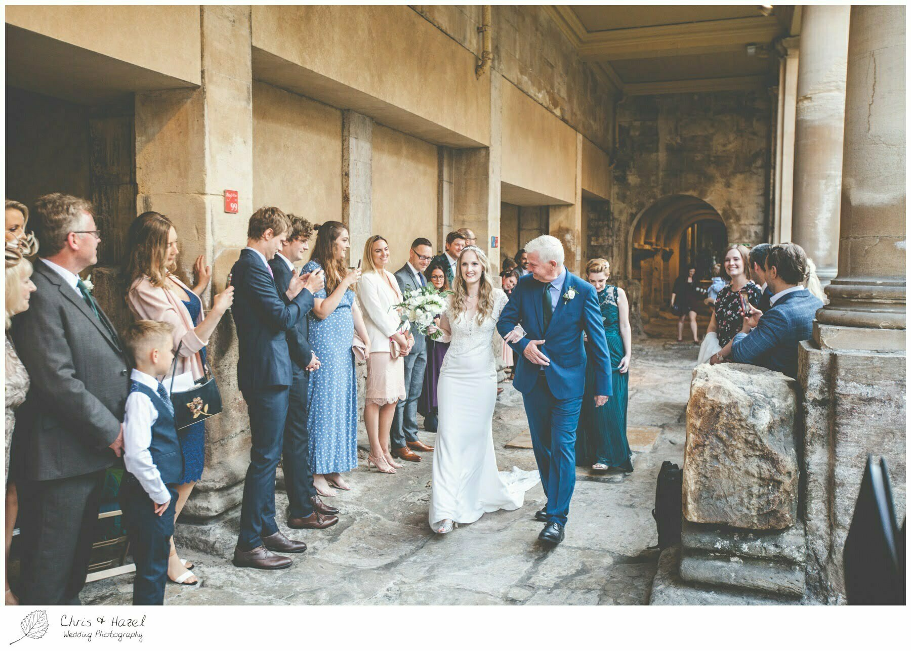Bride and father walking down aisle at Roman Baths Pump Rooms, The Roman Baths Wedding Photography, Roman Baths Wedding Photographer, Wedding in Bath, Bath Wedding Day, documentary wedding photography, Chris and Hazel Wedding Photography Bath, Andy Frost Sian Upson