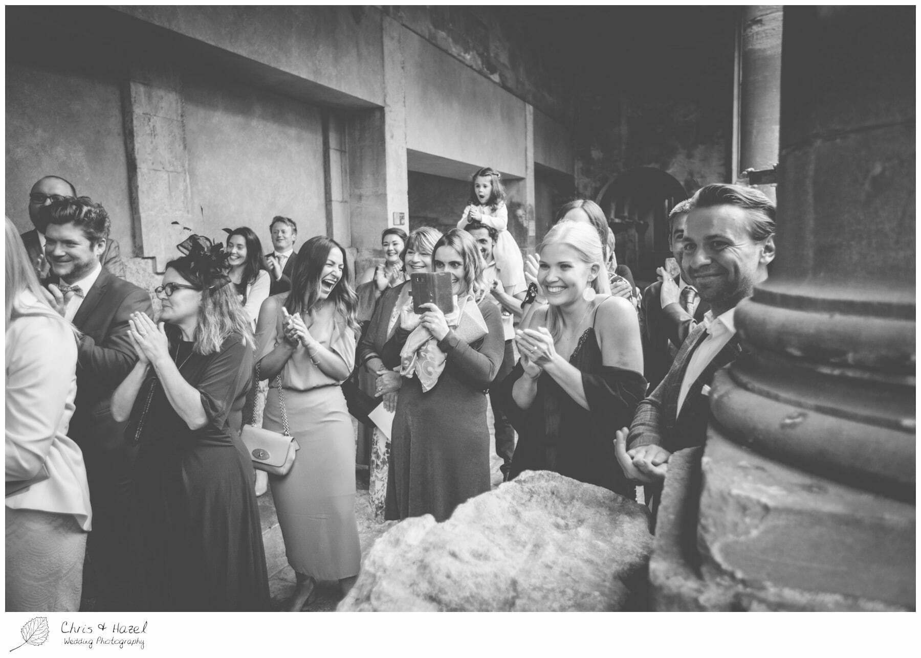 Weeding guests reaction, Ceremony Wedding Guests at Roman Baths Pump Rooms, The Roman Baths Wedding Photography, Roman Baths Wedding Photographer, Wedding in Bath, Bath Wedding Day, documentary wedding photography, Chris and Hazel Wedding Photography Bath, Andy Frost Sian Upson