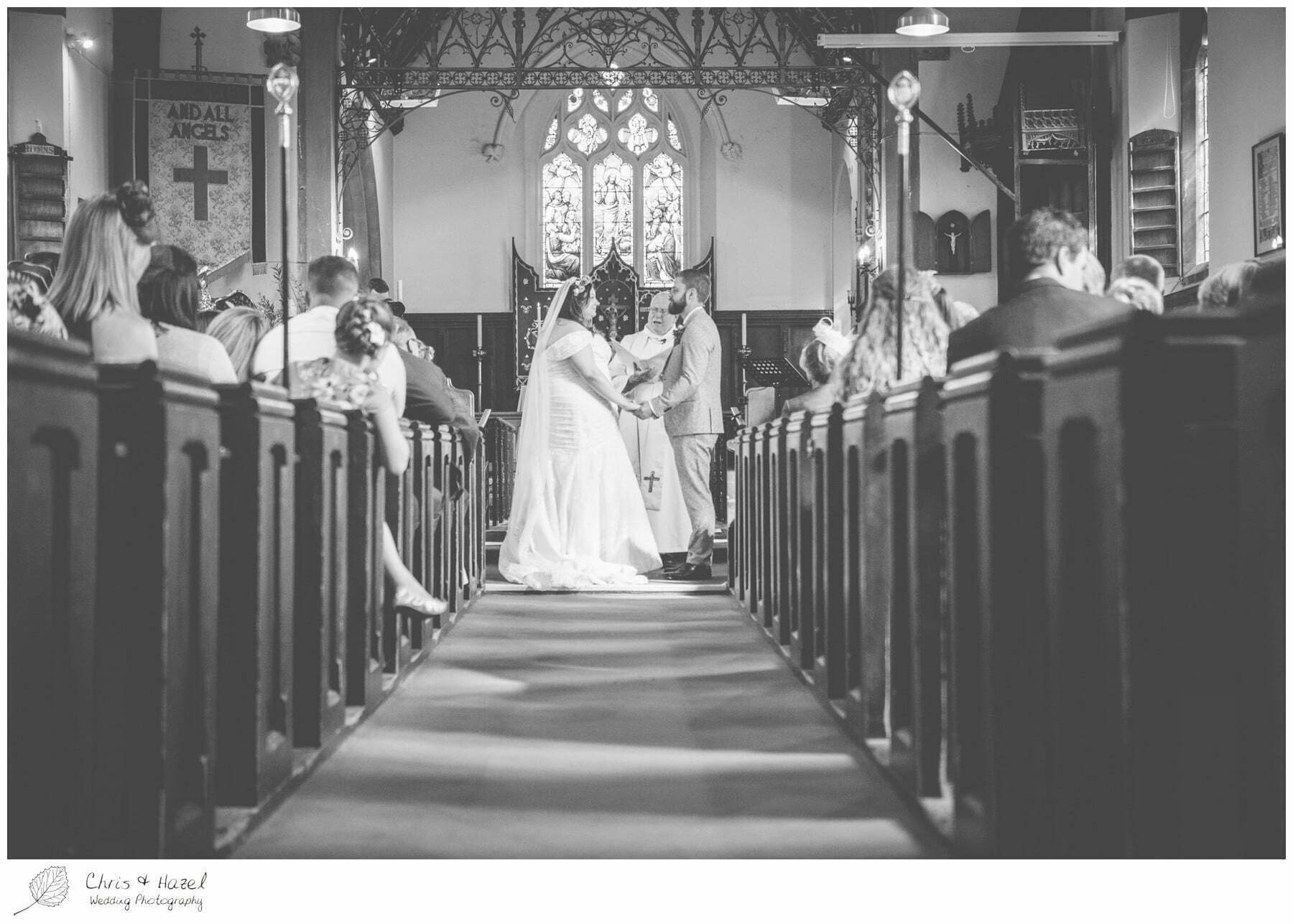 Bride and groom at altar, Hilperton Church, St Michael & All Angels' Church, Wedding Photography, Wiltshire Wedding Photographer Trowbridge, Chris and Hazel Wedding Photography
