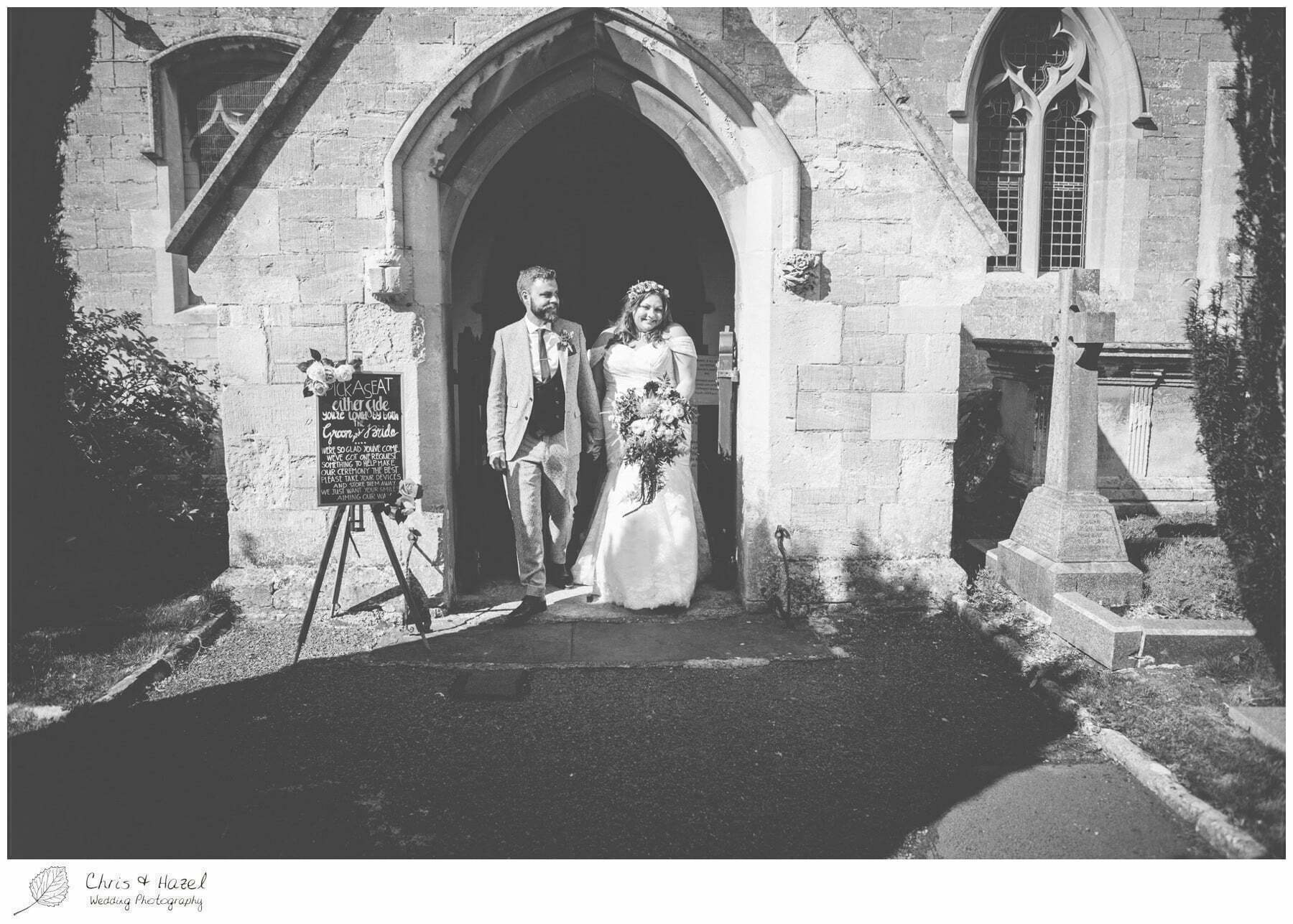 Bride and groom leaving the church, Hilperton Church, St Michael & All Angels' Church, Wedding Photography, Wiltshire Wedding Photographer Trowbridge, Chris and Hazel Wedding Photography